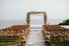 """Monique & Chung's destination wedding in Phuket was held in a stunning private villa overlooking the ocean.  The theme colours of this wedding were pale blue mixed with white, ivory and peach with an overall """"rustic/glam"""" feel."""