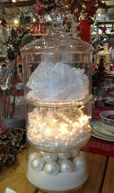 Yule style!! Stacking glass containers with wonderful DIY for Noel Christmas display! Love the added battery-powered lights!