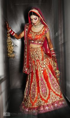 Indian bride wearing Red and pink bridal lehenga and jewellery