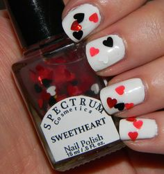 Hearts on white nails