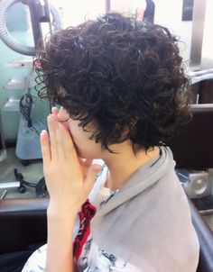 Adorable. If I had ever gotten permed, I would have loved to have looked up at the mirror and seen cute tousled, unruly curls like this.