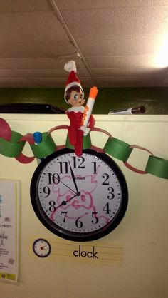 Elf on the Shelf: Defacing all the clocks, mirrors, and tvs in the building with Christmas cheer. Tvs, Elf On The Shelf, Clocks, Mirrors, Contemporary Art, Cheer, Shelves, Holiday Decor, Building