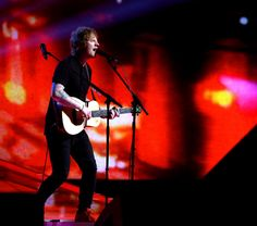 Ed Sheeran electrifies at the Brit Awards at London's O2 Arena Feb. 25. (Joel Ryan/Invision/AP)