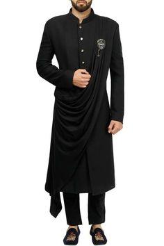 Black draped achkan with pants by Gujral Sons Wedding Kurta For Men, Wedding Dresses Men Indian, Indian Wedding Wear, Wedding Dress Men, Western Dresses For Mens, Wedding Suits, Mens Indian Wear, Mens Ethnic Wear, Indian Groom Wear