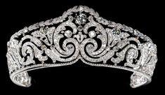 Scroll Tiara, Cartier Paris, c.1910  Platinum, one cushion-shaped diamond, round old-cut diamonds Millegrain setting.