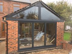 A 3 pane AluK aluminium bi folding door in RAL 7016 Anthracite grey with a Kömmerling UK shaped Upvc frame in matching Anthracite Grey. Installed in Kimberly, Nottingham. House Extension Plans, Rear Extension, Extension Ideas, Upvc Windows, Windows And Doors, Upvc Bifold Doors, Modern Conservatory, Window Company, House Extensions