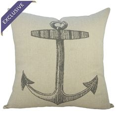 Lend a touch of coastal-chic flair to your reading nook or guest suite with this handmade pillow, featuring a delightful anchor motif. .