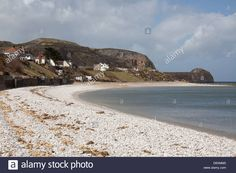 Download this stock image: The Wales Coastal Path in North Wales. Pebble beach at Penrhyn Bay, with the Little Orme in the background. - D6XMM0 from Alamy's library of millions of high resolution stock photos, illustrations and vectors.