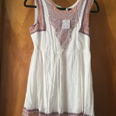 FREE PEOPLE heart stopper dress Ivory with multicolored boho print. Never been worn. Tags still on Free People Dresses Mini