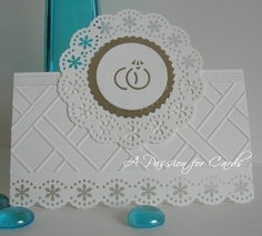 Buy a lace effect punch for plain white wedding invites. Intertwined M on front (in colour of theme)