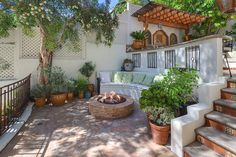 Tyra Banks Selling Romantic Spanish Colonial in Beverly Hills Fire pit area tucked away in a cozy corner. Tyra Banks' Spanish Colonial house in Beverly Hills Spanish Colonial Homes, Spanish Style Homes, Spanish House, Spanish Revival, Spanish Kitchen, Spanish Bungalow, Spanish Courtyard, Spanish Garden, Spanish Backyard