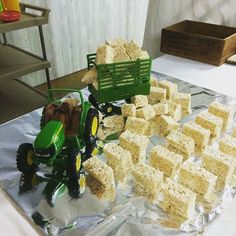 John Deere Tractor and Rice Krispie Treats (hay bales) - what a cute idea for a little boy's birthday party!