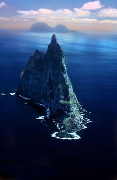 A curious erosional remnant of a shield volcano that formed about 7 million years ago. Balls Pyramid is 20km southeast of Lord Howe Island in the Pacific Ocean. It is 562m (1844 ft) high, while measuring only 1100m (3600 ft) in length and 300m (1000 ft) across, making it the tallest volcanic stack in the world.