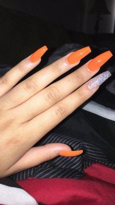 """If you're unfamiliar with nail trends and you hear the words """"coffin nails,"""" what comes to mind? It's not nails with coffins drawn on them. Although, that would be a cute look for Halloween. It's long nails with a square tip, and the look has. Best Acrylic Nails, Acrylic Nail Designs, Orange Acrylic Nails, Red Orange Nails, Orange Nail Designs, Acrylic Nail Art, Cute Nails, Pretty Nails, Hair And Nails"""