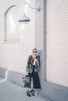 Black and gold fringe jacket with culotte pants