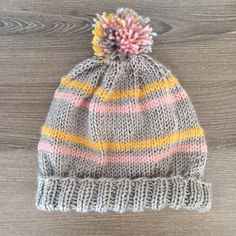 Make this gorgeous and stylish striped pom pom beanie. Free pattern!