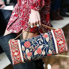 An intricate embroidered brocade floral complements this satchel's clean lines #toryburch #toryfall14  #nyfw