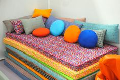 foam pads coved in fabric with piping along the edge. makes a cushy sofa or reading nook in the playroom, and can be pulled apart for multiple sleepover guests, movie night pillows, or tumbling games.