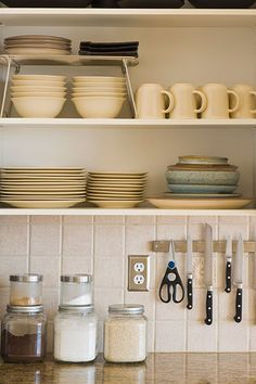 If you're not sure if open shelving is for you, try removing a pair of cabinet doors from your existing kitchen cabinets to give the look a test run. You can always put them back if you decide that 'open clutter' gives you the heebie-jeebies.