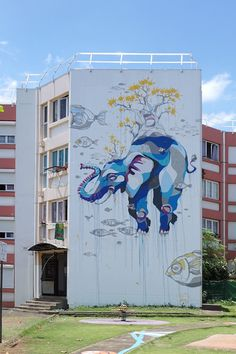 Recently several street artists including Gorg One, Seth Globepainter, and Meo gathered for a street art festival on Reunion Island to turn the La Rose des Vents neighborhood into a mural haven, covering many of its large walls in representational depictions of children, elephants, and sea creatures