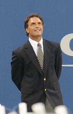 "Doug Flutie aka Douglas Richard Flutie (born Oct 23, 1962) raised Natick Mass is a former quarterback in the NFL, CFL,and USFL. He first rose to prominence during his college football career at Boston College, where he received the Heisman Trophy and the Davey O'Brien National Quarterback Award in 1984. His ""Hail Mary"" touchdown pass in a game against Miami on Nov 23,1984 is considered among the greatest moments in college football and American sports history."