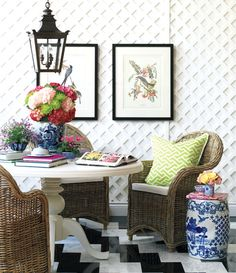 Trellis wall + blue and white accents + marble chevron floor toned down by neutral wicker = fabulous