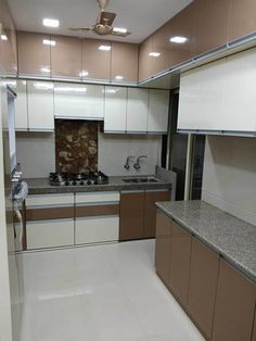 This apartment in Mira Road,Thane is complete with modern interiors including a high gloss laminate kitchen with premium fittings. This spacious home is designed with elegant theme and painted with light colours. Kitchen Cupboard Designs, Kitchen Room Design, Modern Kitchen Design, Home Decor Kitchen, Kitchen Layout, Interior Design Kitchen, Kitchen Wardrobe Design, Wardrobe Interior Design, Latest Kitchen Designs