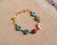 Check out this item in my Etsy shop https://www.etsy.com/listing/248387317/christmas-bracelet-from-polymer-clay