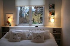 Pretty bedroom with custom built headboard to cover the radiator. Chez Larsson.