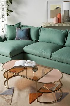 Each piece is a superb amalgam of craftsmanship. Case in point: this sleek coffee table blends contemporary and mid-century design with tinted glass set in a curved frame. This would look great in any contemporary living room.