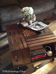 DIY Vintage Chic: Wooden Crate Coffee Table -- these would be relatively easy to make, and great for informal seating areas. Make a couple - one that we could keep after the wedding, one that you could keep? Fill center with flowers, battery operated candle, lanterns etc..... something that would go with the wedding theme.