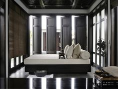 Awesome bedroom...love the pivot doors. Something like this might work in my basement.