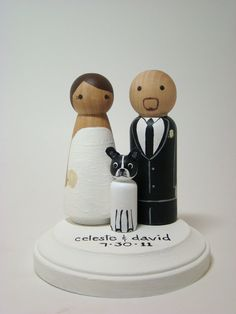 We loved our customized wedding cake topper! Painted Wood Pegs