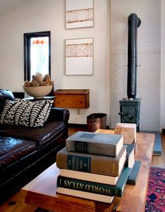 Piles, books, leather sofas, Persian rugs