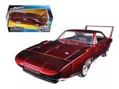 "1969 Dodge Charger Daytona Red ""Fast & Furious 7"" Movie 1/24 Diecast Model Car by Jada - Brand new 1:24 scale diecast model car of 1969 Dodge Charger Daytona Red ""Fast & Furious 7"" Movie die cast car model by Jada. Rubber tires. Brand new box. Detailed interior, exterior. Has opening hood, doors and trunk. Made of diecast with some plastic parts. Dimensions approximately L-8, W-3.75, H-3.25 inches. Please note that manufacturer may change packing box at anytime. Product will stay exactly the…"