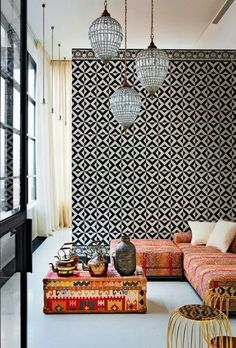 (C) 5. Emphasis The tile on the wall in the background draws attention the designs creating emphasis. The dark colors and patterns are dominant in this room.