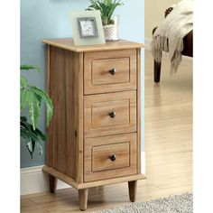 Charmingly designed to fit any small space, this compact side table offers room for storing your knick-knacks with the help of its three spacious drawers. Available in two finishes, this side table is sure to provide much-needed storage space.