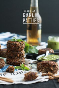 A savoury, earthy vegetarian recipe for patties made of dark French lentils, garlic, oat and spices makes for a great brunch or picnic dish. Served with a vibrant green sauce.