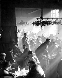 Cattle Dealers in Café, Nijmegen (1957) by Wim K. Steffen/// the lighting!