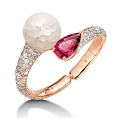 de GRISOGONO Boule frozen quartz and rubellite bracelet like fire and ice: with white and dark pink red coming together with champagne diamonds. The best fashion forward jewellery moments from Baselworld day 2: http://www.thejewelleryeditor.com/jewellery/top-5/baselworld-jewellery-day-one-highlights/ #jewelry