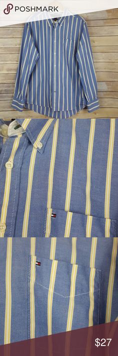 """Tommy Hilfiger men's long sleeve light blue shirt Tommy Hilfiger size large slim fit, long sleeve light blue with yellow and white stripes,  100% cotton, flat lay measurements are about.. 19 1/2"""" shoulders, 23"""" from arm pit to arm pit, 26"""" sleeve length, 31"""" length, excellent condition, smoke free home Tommy Hilfiger Shirts Casual Button Down Shirts"""
