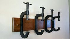 hooks from c- clamps, very cute for hubby's garage where he can hang his carpenter belt, welding hood, gloves, cap, you name it!