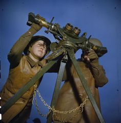 The Auxiliary Territorial Service at An Anti-aircraft Gun Site in Britain, December 1942 ATS girls using an identification telescope.