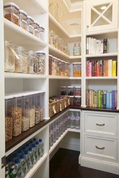 """I like the bookshelf being in the Butlers Pantry. I love the containers (having room behind for the packages). Don't like the colour of cabinetry or """"country"""" style but layout is good."""