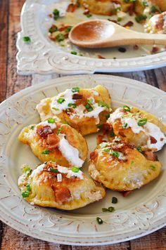 Bacon, Cheddar, and Caramelized Onion Potato Pierogi!  These pierogi (or perogies, or however you like to spell it) are so delicious and they're surprisingly easy to make.  Seriously, you can do it!  They make great appetizers, too! | blog.hostthetoast.com