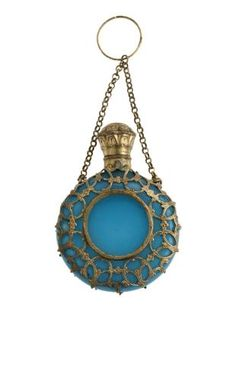 Scent bottle of semi-opaque blue glass encased in a gilt metal network of scrolls, with a gilt metal mount with hinged cover stamped with a spray of flowers, and a gilt metal ring on a chain attached to the network, part of the Ida Pappenheim Collection: possibly Bohemian, c. 1850