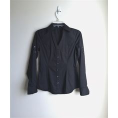 """Express Black Button Down Shirt Express black button down  Classic black button down shirt from Express. Featuring single chest pocket, optional button tab for rolling up cuffs, and V-neck button front. Slimmer at the waist and stretchy fabric makes this the perfect flattering top for any occasion. Note: no care or size tags. Priced accordingly.   * Size XS * Machine Wash  * Import * Retail $59.99+Tax  Approximate Measurements:  * Chest: 17"""" * Waist: 14.5"""" * Length: 24.5"""" Express Tops Button…"""