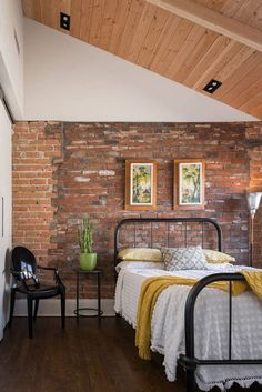 Modern rustic bedroom with exposed brick wall