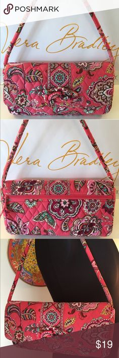 ⭐️VERA BRADLEY SHOULDER BAG 💯AUTHENTIC VERA BRADLEY SHOULDER BAG 100% AUTHENTIC. WHAT A BEAUTIFUL BAG! THE PERFECT SHADE OF PINK. SO STUNNING AND STYLISH AND PERFECT FOR ANY OCCASION! NO STAINS , RIPS OR TEARS . JUST A AMAZING BAG! THIS BAG HAS A VERY LARGE OUTSIDE REAR ZIP POCKET AND THREE ROOMY INTERIOR WALL POCKETS! THE BAG MEASURES 12 INCHES WIDE BY 7 INCHES TALL! THE SHOULDER STRAP HAS A GENEROUS 9 INCH DROP Vera Bradley Bags Shoulder Bags