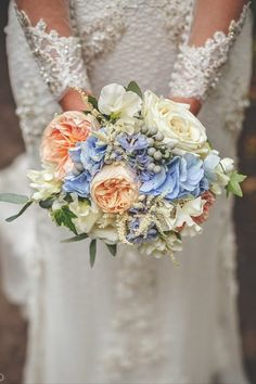 The Flowerstalk are known for their delicately beautiful bouquets, such as this gorgeous white, blue and orange summer arrangement. Wedding Flowers - White, Blue, Summer, Bride, UK